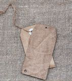 Blank tags retro style on burlap texture Stock Image