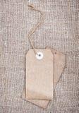 Blank tags retro style on sackcloth Stock Photo