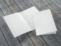 Blank template of folded brochure A4 Size. On a wood background Royalty Free Stock Images