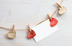 Blank for text input with wooden hearts on the clothespin. Stock Photos
