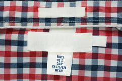 Blank texture label on red, blue and white plaid shirt. Copy space apparel backdrop background border canvas casual closeup clothes clothing color concept stock photo