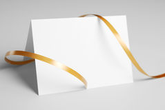 Blank thank you card with golden ribbon. Over gray background Royalty Free Stock Photos