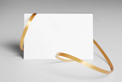 Blank thank you card with golden ribbon. Over gray background stock images