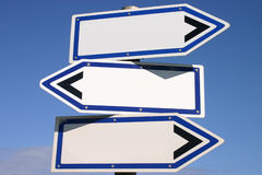 Blank three-way direction signpost. With a blue sky background Stock Photo