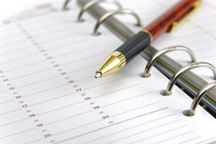 Blank time planner. And pen stock photo