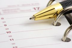 Blank time planner with pen. Ready for your text Stock Photos