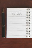 Blank To Do List. A blank to do list. Add your own list.Black pen on the open notebook Royalty Free Stock Photo
