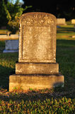 Blank tombstone. Warm light cast over tombstone with no name engraved Stock Photography