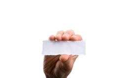 Blank torn notepaper in hand Royalty Free Stock Photography