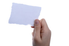 Blank torn notepaper in hand Royalty Free Stock Photo