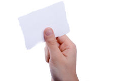 Blank torn notepaper in hand Royalty Free Stock Image