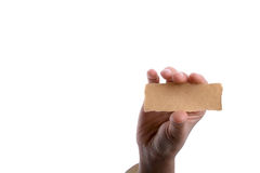 Blank torn notepaper in hand Stock Photo