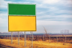 Blank traffic road sign by the roadway Royalty Free Stock Photo