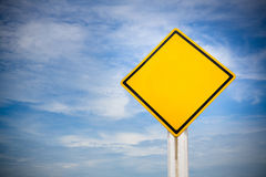 Blank on traffic sign on yellow background with cloudy blue sky. symbol for transportation regulations. image for background royalty free stock photo
