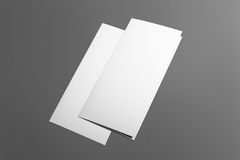 Blank tri fold brochure isolated on grey. To replace your design or message Royalty Free Stock Photo