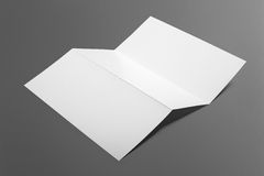 Blank tri fold brochure isolated on grey. To replace your design or message Stock Image