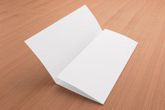 Blank tri fold brochure on wooden background. To replace your design or message Stock Photo