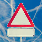 Blank triangular traffic sign Stock Images