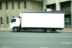 Blank truck. Truck with motion blur suitable for applying an advertising sign to the side Royalty Free Stock Photos