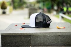 Blank trucker hat cap flat visor with black and white color royalty free stock image