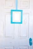 Blank Turquoise Picture Frame on Distressed Door Royalty Free Stock Image