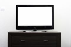 Blank tv screen on brown commode Stock Images
