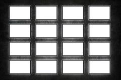 Blank TVs. On dark wall Stock Photo