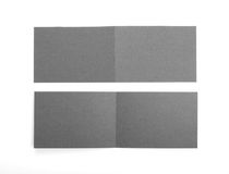 Blank two-fold flyers or leaflets on white. Royalty Free Stock Photos