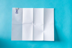 Blank unfolded creased piece of paper Royalty Free Stock Photos