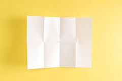 Blank unfolded creased piece of paper Royalty Free Stock Photography