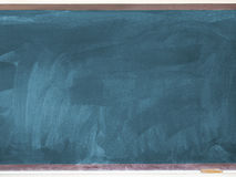 Blank used chalkboard on the classroom Stock Images