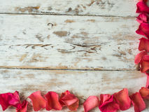 Blank valentine card, scattered rose petals top view. Space for text Royalty Free Stock Photography