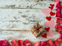Blank valentine card with space for the text., scattered rose petals and gift, top view Stock Photo