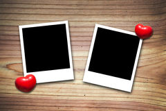 Blank valentine photo frames on wood Royalty Free Stock Photos