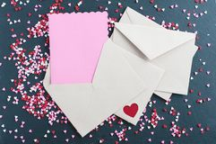 Blank Valentines Day card. And envelope surrounded by little hearts stock images
