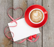 Blank valentines greeting card and red coffee cup Stock Photography