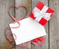 Blank valentines greeting card and small red gift box Royalty Free Stock Photography