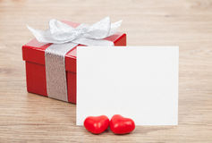 Blank valentines greeting card and small red gift box Stock Image