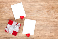 Blank valentines photo frames and small red gift box Royalty Free Stock Image