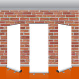 Blank vector roll up banners display mockup. Red brick wall. Royalty Free Stock Photos