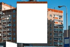 Blank vertical billboard on direct sunlight. Background for mock-up stock images
