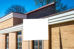 Blank vertical billboard, poster frame, advertising, information board new new unfinished house.  stock images