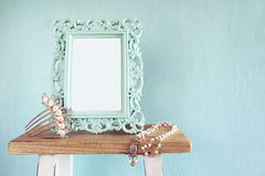 Blank victorian style frame, pearls necklace and hair decoration Royalty Free Stock Photography
