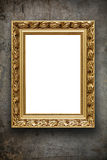 Blank vintage arrtframe on grunge wall Royalty Free Stock Images