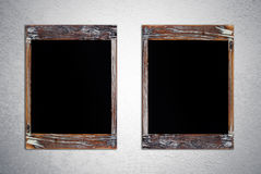 Blank vintage chalk boards on grunge cement wall Stock Photo
