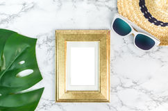Blank Vintage golden color picture frame on green monstera leaf Stock Photo