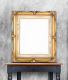 Blank vintage golden photo frame lean at gray color concrete wal Royalty Free Stock Photo