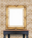 Blank vintage golden photo frame lean at pale orange brick wall Royalty Free Stock Photos
