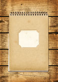 Blank vintage notebook on a wood board Stock Photos