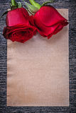 Blank vintage paper red scented roses on wooden board Royalty Free Stock Photography